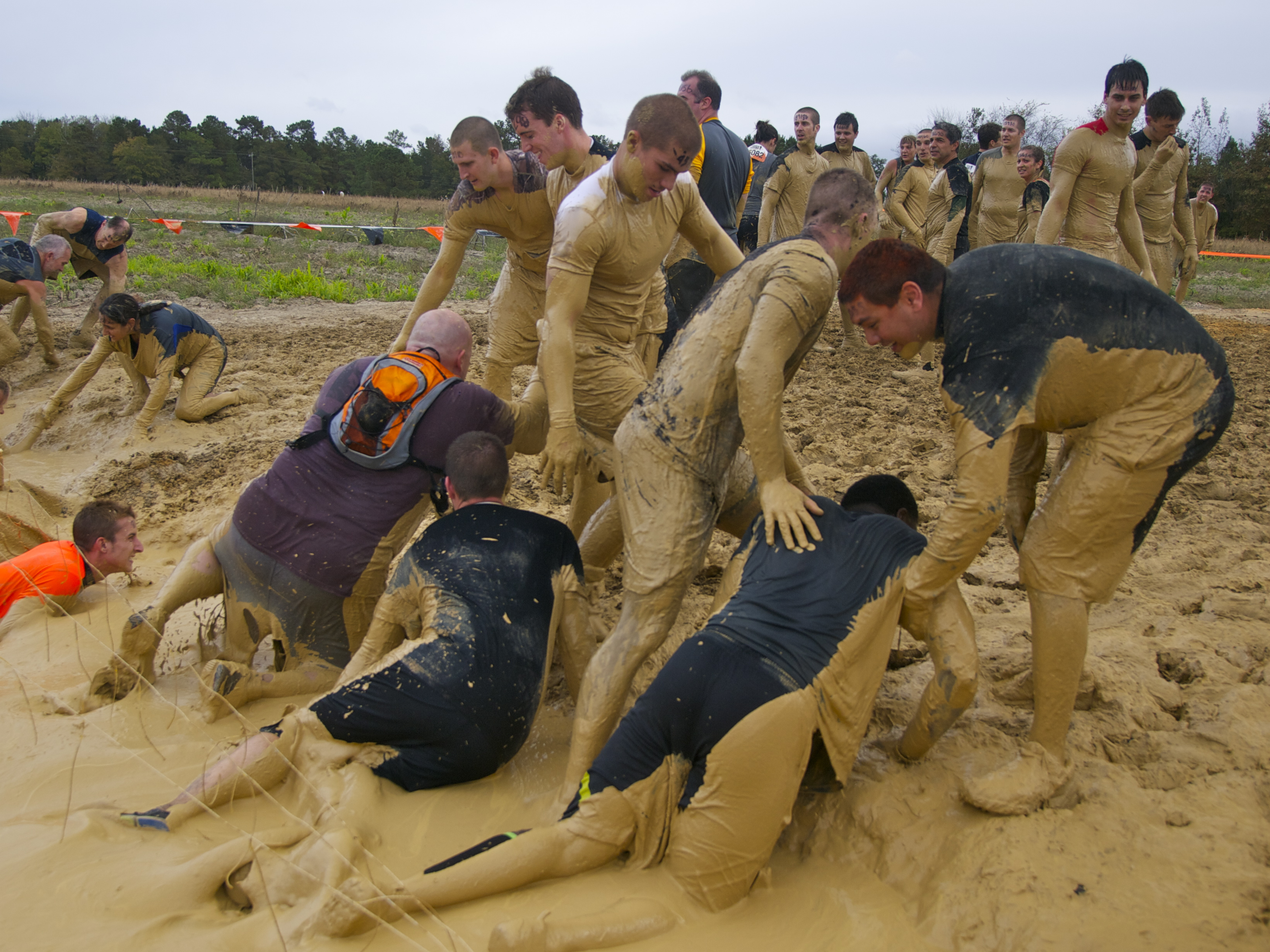 Tough Mudders emerging from the Electric Eel. The toughest race on Earth ...