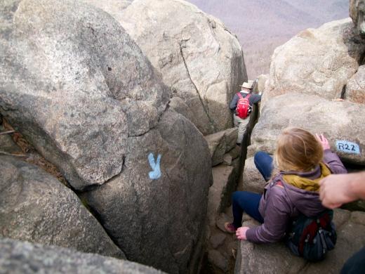 A big drop down between boulders.