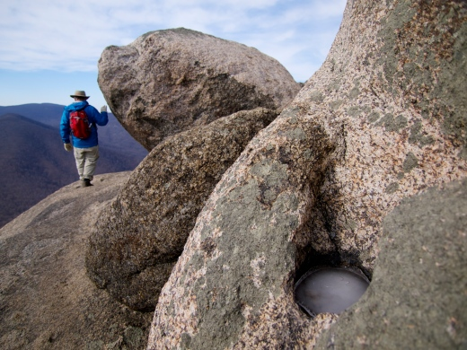 My dad next to the summit boudlers on Old Rag. Notice the icy pothole in the foreground. These pits, called Opferkessels, are created by gradual dissolution of the rock by standing water.
