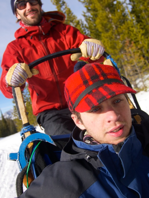 Dan driving the sled with Tristan riding along