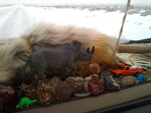 Dashboard altar to the gods of winter road tripping